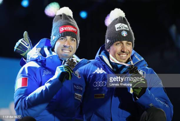 Bronze medalists Federico Pellegrino and Francesco De Fabiani of Italy pose with the medals during the medal ceremony for the Mens' Cross Country...