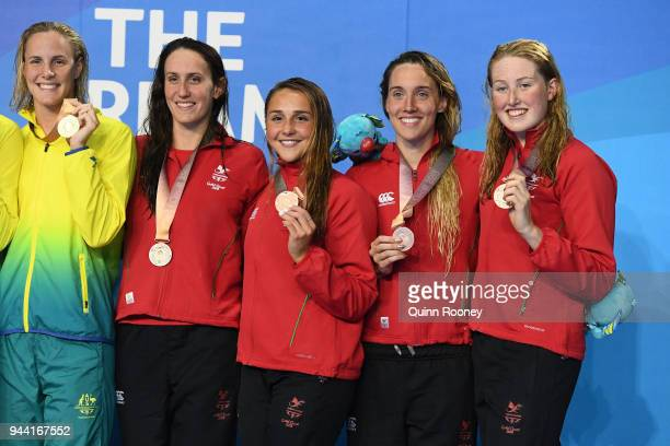 Bronze medalists Georgia Davies Chloe Tutton Alys Thomas and Kathryn Greenslade of Wales pose during the medal ceremony for the Women's 4 x 100m...