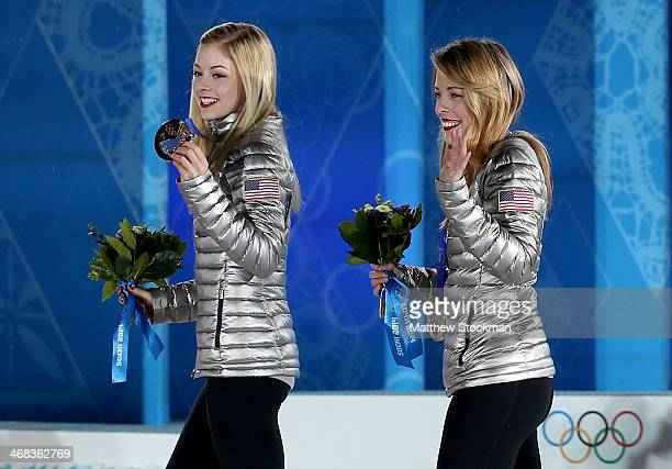Bronze medalists Gracie Gold and Ashley Wagner of the United States celebrate during the medal ceremony for the Team Figure Skating Overall on day 3...