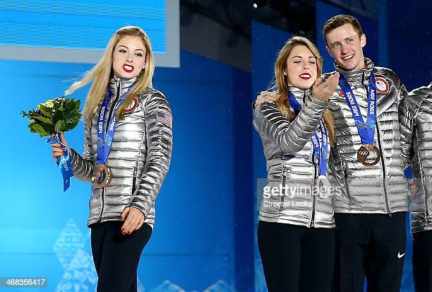 Bronze medalists Gracie Gold Ashley Wagner and Jeremy Abbott of the United States celebrate during the medal ceremony for the Team Figure Skating...