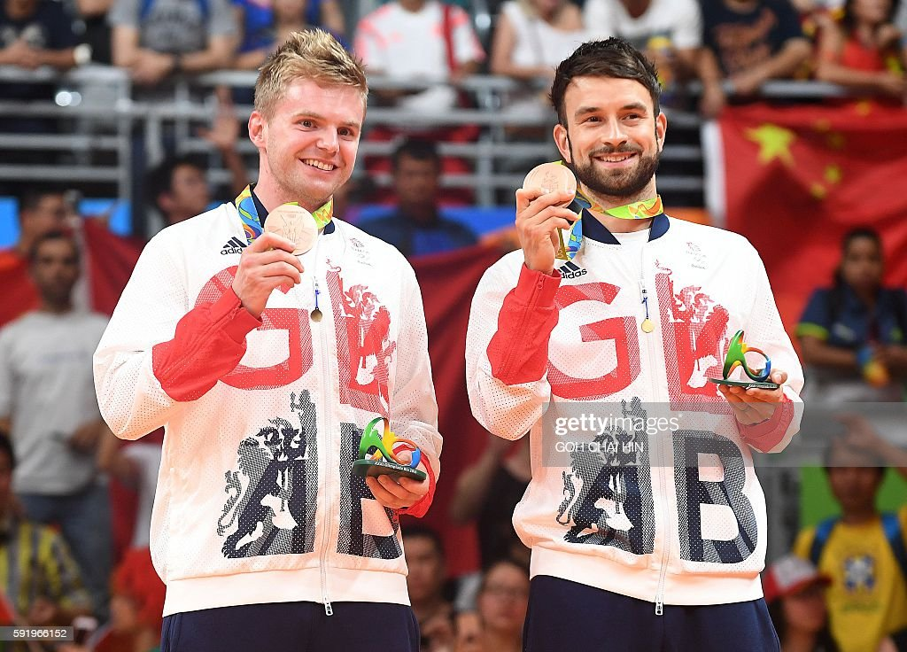 Bronze medalists Great Britain's Marcus Ellis (L) and Great Britain's Chris Langridge stand with their medals on the podium following the men's doubles Gold Medal badminton match at the Riocentro stadium in Rio de Janeiro on August 19, 2016, for the Rio 2016 Olympic Games. / AFP / GOH Chai Hin