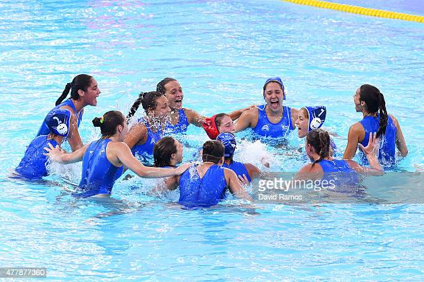 Bronze medalists Greece celebrate following their victory during the Women's Waterpolo bronze medal match between Italy and Greece on day eight of...