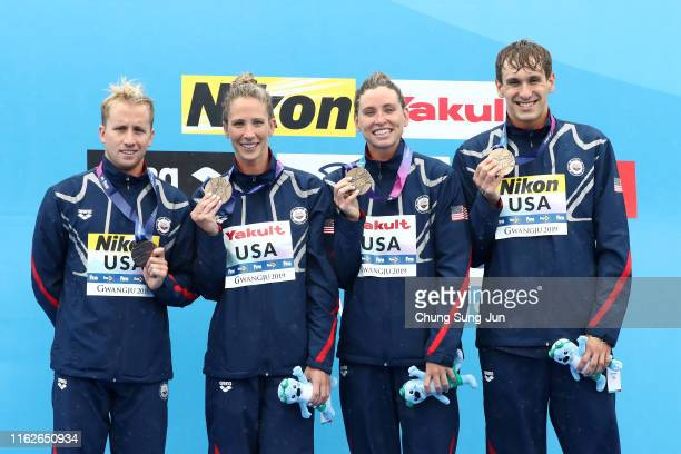 Bronze medalists Haley Anderson Jordan Wilimovsky Ashley Twichell and Michael Brinegar of Team USA pose during the medal ceremony for the Mixed 5km...
