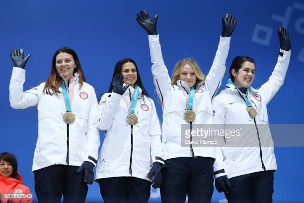 Bronze medalists Heather Bergsma Brittany Bowe Mia Manganello and Carlijn Schoutens of the United States celebrate during the medal ceremony for...