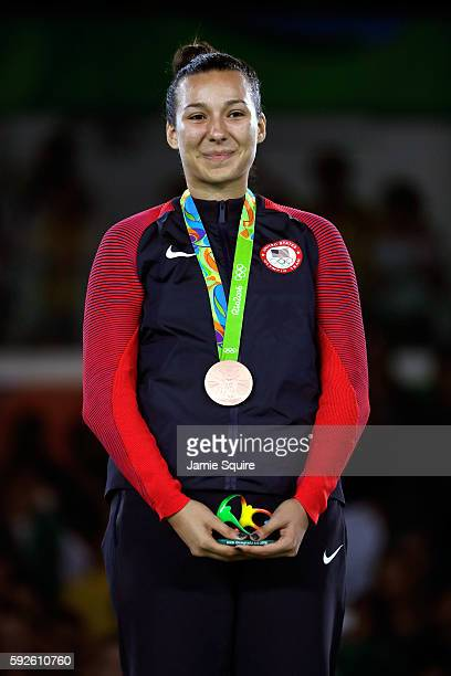 Bronze medalists Jackie Galloway of the United States celebrates on the podium during the medal ceremony for the Taekwondo Women 67kg Gold Medal...