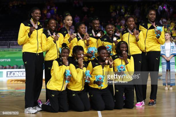 Bronze medalists Jamaica pose during the medal ceremony for the Netball Gold Medal Match on day 11 of the Gold Coast 2018 Commonwealth Games at...