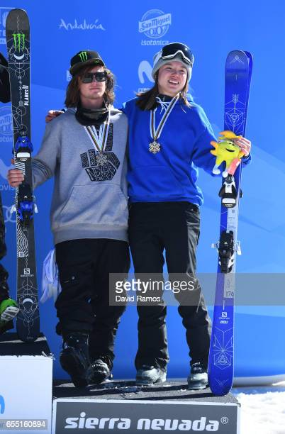 Bronze medalists James Woods of Great Britain and Isabel Atkin of Great Britain pose during the medal cermony for the Slopestyle finals on day twelve...