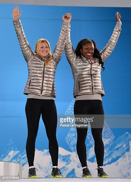Bronze medalists Jamie Greubel and Aja Evans of the United States team 2 celebrate during the medal ceremony for the Women's Bobsleigh on day...