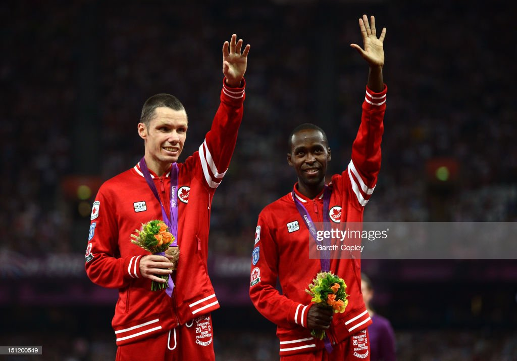 Bronze medalists Jason Joseph Dunkerley of Canada and his guide Josh Karanja pose on the podium during the medal ceremony for the Men's 1500m - T11 on day 5 of the London 2012 Paralympic Games at Olympic Stadium on September 3, 2012 in London, England.
