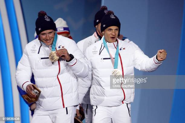 Bronze medalists Jean Marc Gaillard Maurice Manificat Clement Parisse and Adrien Backscheider of France celebrate during the medal ceremony for the...
