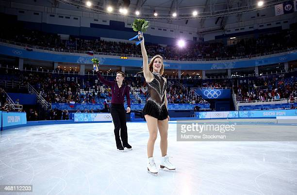 Bronze medalists Jeremy Abbott and Ashley Wagner of the United States celebrate after the flower ceremony for the Team Figure Skating Overall during...