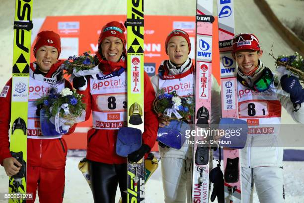 Bronze medalists Junshiro Kobayashi Noriaki Kasai Ryoyu Kobayashi and Taku Takeuchi of Japan celebrate at the medal ceremony in the FIS Ski Jumping...