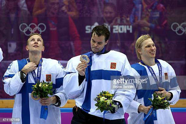 Bronze medalists Juuso Hietanen Tuukka Rask and Antti Pihlstrom of Finland celebrate during the medal ceremony after defeating the United States 50...