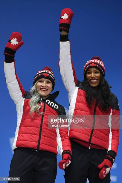 Bronze medalists Kaillie Humphries and Phylicia George of Canada celebrate during the medal ceremony for Bobsleigh - Women on day 13 of the...
