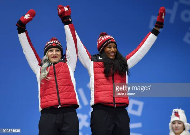 Bronze medalists Kaillie Humphries and Phylicia George of Canada celebrate during the medal ceremony for Bobsleigh Women on day 13 of the PyeongChang...