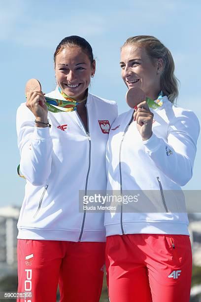 Bronze medalists Karolina Naja and Beata Mikolajczyk of Poland celebrate on the podium during the Women's Kayak Double 500m Final A on Day 11 of the...