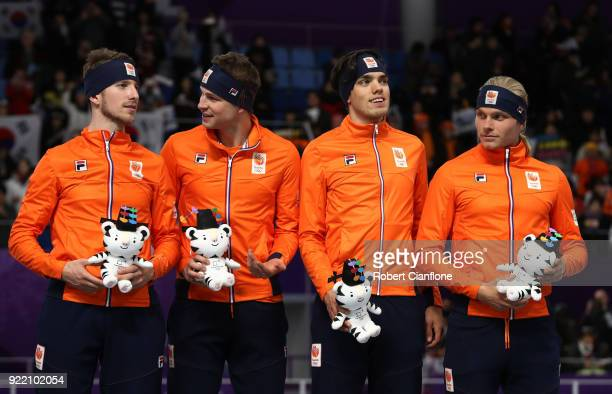 Bronze medalists Koen Verweij Patrick Roest Sven Kramer and Jan Blokhuijsen of the Netherlands stand on the podium during the victory ceremony after...