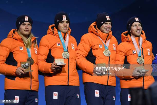 Bronze medalists Koen Verweij Patrick Roest Sven Kramer and Jan Blokhuijsen of the Netherlands stand on the podium during the medal ceremony for...