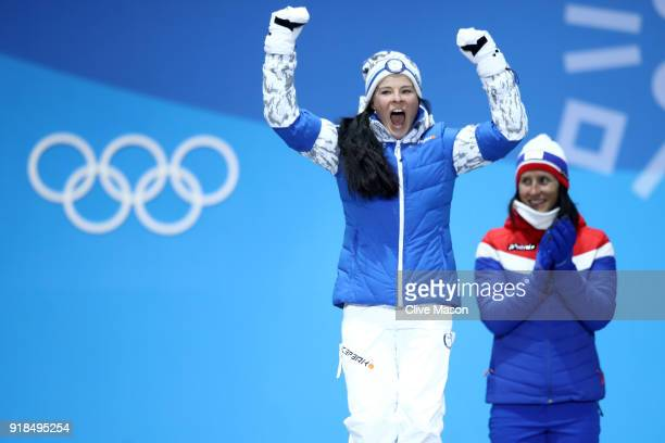 Bronze medalists Krista Parmakoski of Finland and Marit Bjoergen of Norway celebrate during the medal ceremony for CrossCountry Skiing Ladies' 10km...