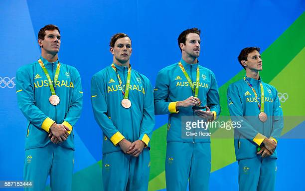 Bronze medalists Kyle Chalmers James Magnussen James Roberts and Cameron McEvoy of Australia pose on the podium during the medal ceremony for the...