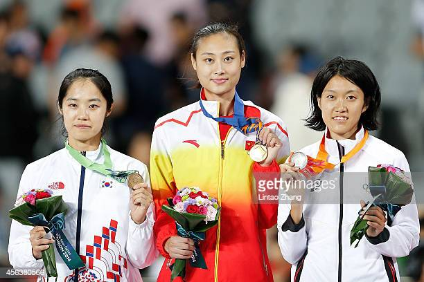 Bronze medalists Lim Eunji of South Korea, Li Ling of China and Silver medalists Tomomi Abiko of Japan celebrate during the medal ceremony after the...