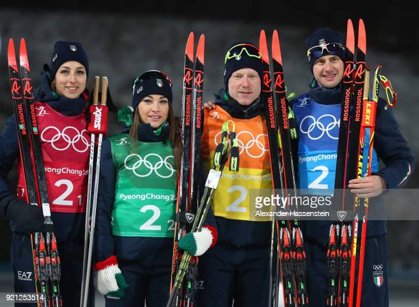 Bronze medalists Lisa Vittozzi Dorothea Wierer Lukas Hofer and Dominik Windisch of Italy celebrate during the victory ceremony after the Biathlon...