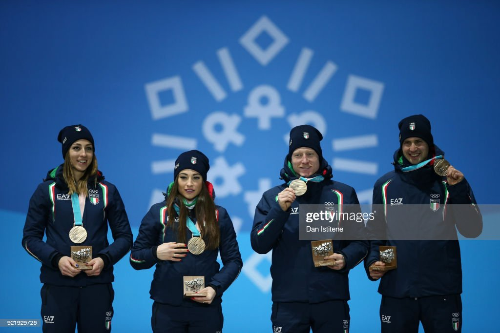 Bronze medalists Lisa Vittozzi, Dorothea Wierer, Lukas Hofer and Dominik Windisch of Italy celebrate during the medal ceremony for the Biathlon 2x6km Women + 2x7.5km Men Mixed Relay on day twelve of the PyeongChang 2018 Winter Olympic Games at Medal Plaza on February 21, 2018 in Pyeongchang-gun, South Korea.