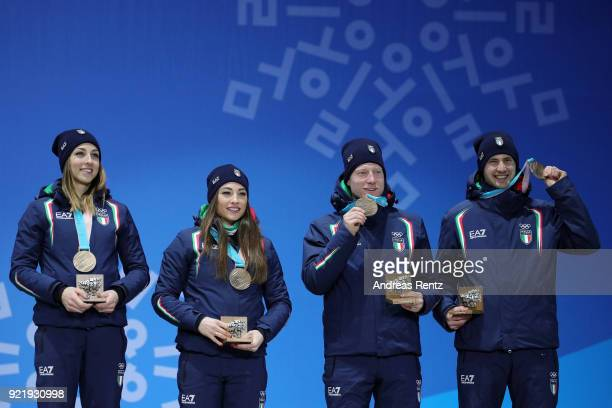 Bronze medalists Lisa Vittozzi Dorothea Wierer Lukas Hofer and Dominik Windisch of Italy celebrate during the medal ceremony for the Biathlon 2x6km...