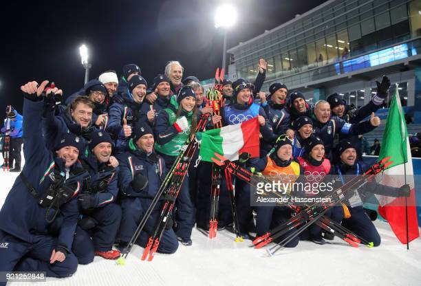 Bronze medalists Lisa Vittozzi Dorothea Wierery Dominik Windisch and Lukas Hofer of Italy celebrate with their team after the victory ceremony for...