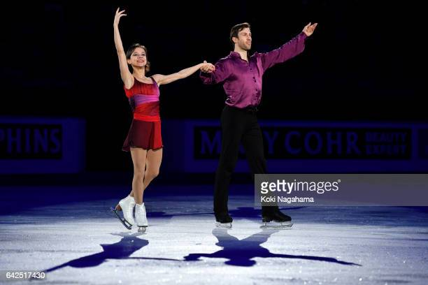 Bronze medalists Liubov Ilyushechkina and Dylan Moscovitch of Canada wave for fans prior to the medals ceremony of the Pairs during ISU Four...