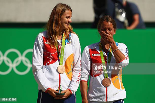 Bronze medalists Lucie Safarova and Barbora Strycova of the Czech Republic pose on the podium during the ceremony for the women's doubles on Day 9 of...