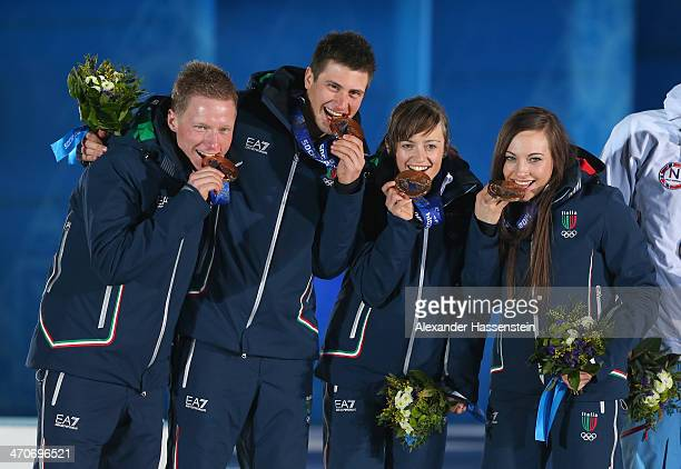 Bronze medalists Lukas Hofer Dominik Windisch Karin Oberhofer and Dorothea Wierer of Italy celebrate during the medal ceremony for the 2 x 6 km Women...