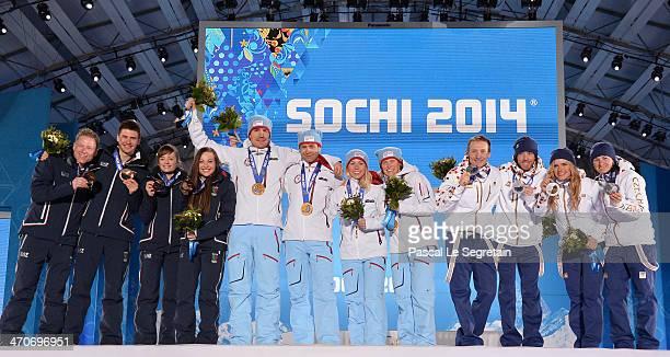 Bronze medalists Lukas Hofer, Dominik Windisch, Karin Oberhofer and Dorothea Wierer of Italy, gold medalists Emil Hegle Svendsen, Ole Einar...