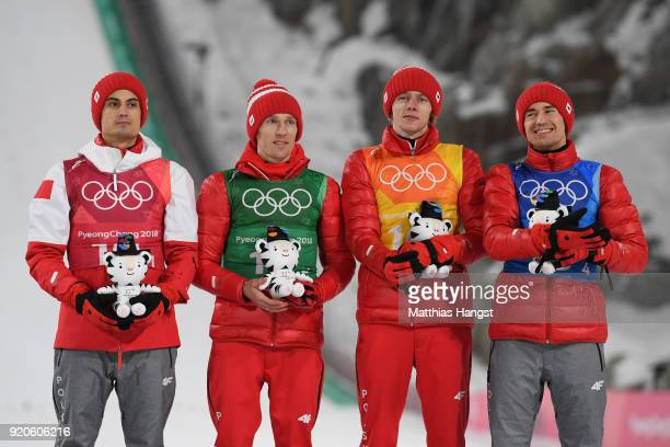 Bronze medalists Maciej Kot Stefan Hula Dawid Kubacki and Kamil Stoch of Poland celebrate on the podium during the Ski Jumping Men's Team Large Hill...