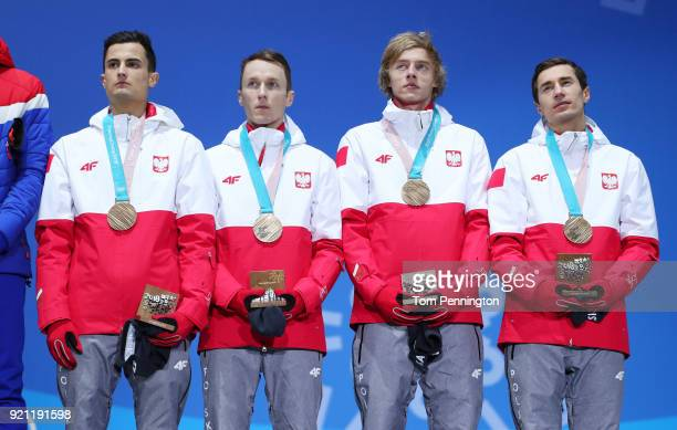 Bronze medalists Maciej Kot Stefan Hula Dawid Kubacki and Kamil Stoch of Poland stand on the podium during the medal ceremony for Ski Jumping Men's...