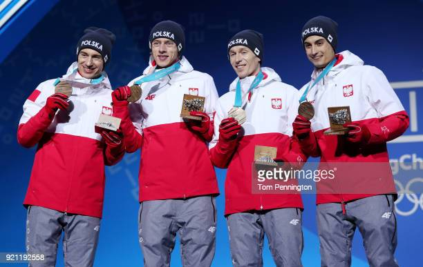 Bronze medalists Maciej Kot Stefan Hula Dawid Kubacki and Kamil Stoch of Poland celebrate during the medal ceremony for Ski Jumping Men's Team on day...