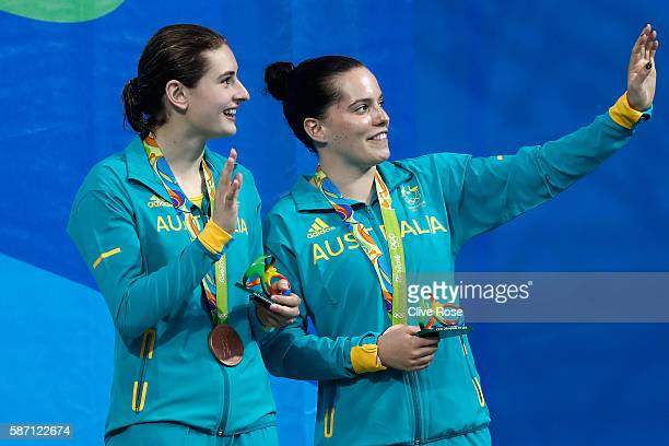 Bronze medalists Maddison Keeney and Anabelle Smith of Australia pose on the podium during the medal ceremony for the Women's Diving Synchronised 3m...