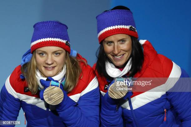 Bronze medalists Maiken Caspersen Falla and Marit Bjoergen of Norway celebrate during the medal ceremony for CrossCountry Skiing Ladies' Team Sprint...