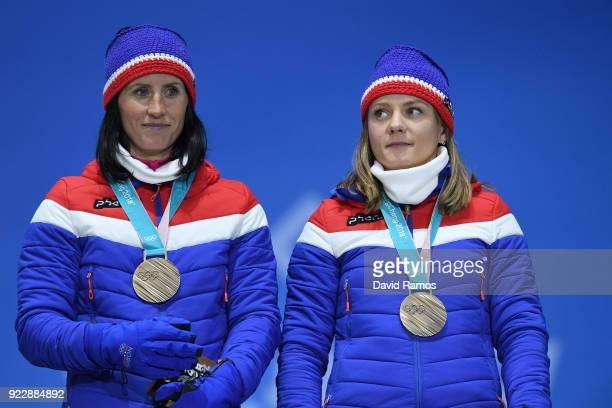 Bronze medalists Marit Bjoergen and Maiken Caspersen Falla of Norway stand on the podium during the medal ceremony for CrossCountry Skiing Ladies'...