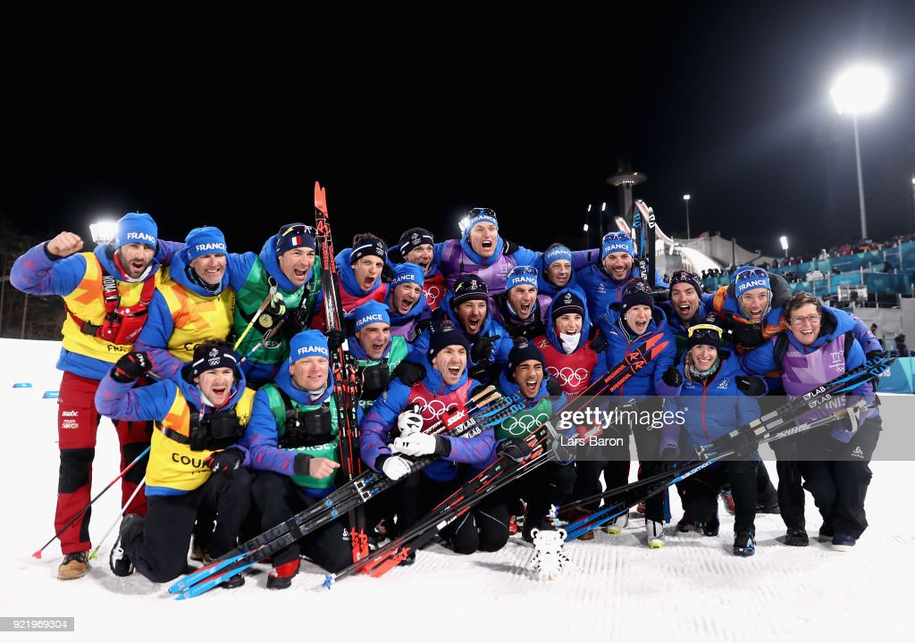 Bronze medalists Maurice Manificat and Richard Jouve of France celebrate with coaches and team mates after the Cross Country Men's Team Sprint Free on day 12 of the PyeongChang 2018 Winter Olympic Games at Alpensia Cross-Country Centre on February 21, 2018 in Pyeongchang-gun, South Korea.
