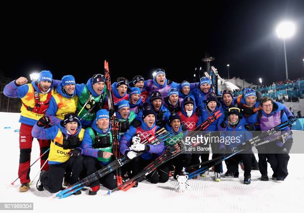 Bronze medalists Maurice Manificat and Richard Jouve of France celebrate with coaches and team mates after the Cross Country Men's Team Sprint Free...