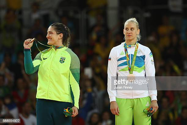 Bronze medalists Mayra Aguiar of Brazil and Anamari Velensek of Slovenia celebrate on the podium after the women's -78kg bronze medal judo contest on...