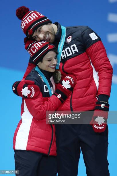 Bronze medalists Meagan Duhamel and Eric Radford of Canada celebrate during the medal ceremony for the Pair Skating Free Skating on day six of the...
