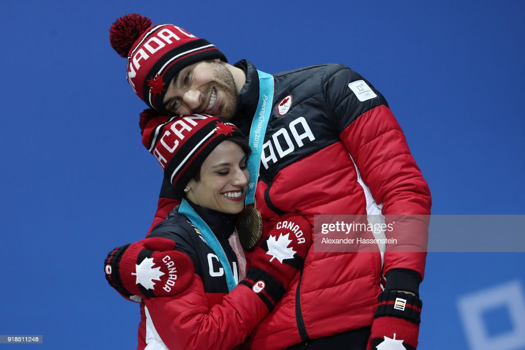 https://media.gettyimages.com/photos/bronze-medalists-meagan-duhamel-and-eric-radford-of-canada-celebrate-picture-id918511248?k=6&m=918511248&s=594x594&w=0&h=sdxg3kbHBWOCqsenzEjyz9yZ5j-SBXgrmsScYX6APMo=