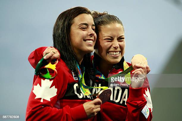 Bronze medalists Meaghan Benfeito and Roseline Filion of Canada celebrate during the medal ceremony for the Women's Diving Synchronised 10m Platform...