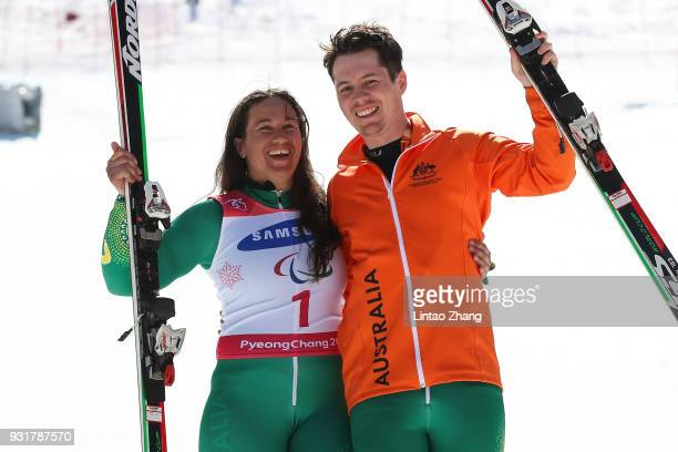 Bronze Medalists Melissa Perrine of Australia and her guide Christian Geiger celebrates at the victory ceremony for Women's Giant Slalom Run 2...