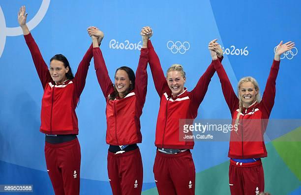 Bronze medalists Mie Nielsen Rikke Pedersen Jeanette Ottesen and Pernille Blume of Denmark pose during the medal ceremony for the Women's 4 x 100m...
