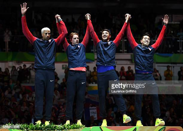 Bronze medalists Miles ChamleyWatson Race Imboden Alexander Massialas and Gerek Meinhardt of the United States celebrate on the podium for the Men's...