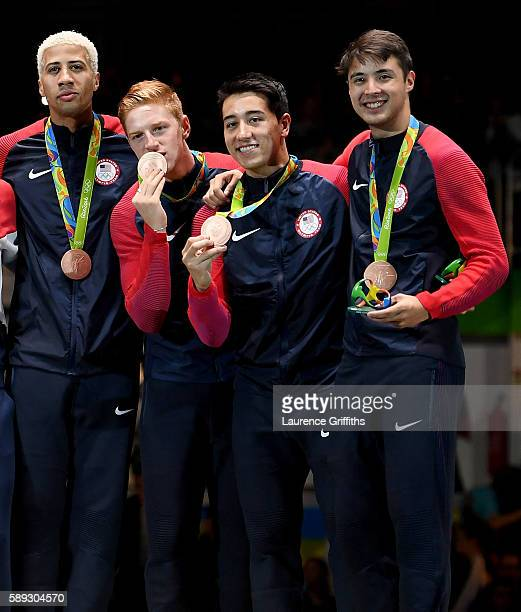 Bronze medalists Miles ChamleyWatson Race Imboden Gerek Meinhardt and Alexander Massialas stand on the podium during the medal ceremony for the Men's...
