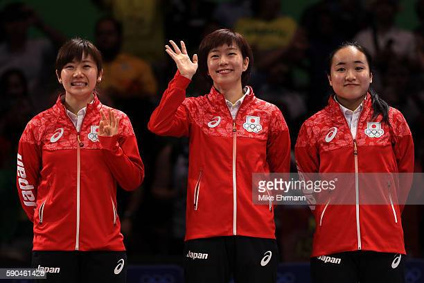 Bronze medalists Mima Ito, Kasumi Ishikawa and Ai Fukuhara of Japan pose on the podium during the medal ceremony for the Women's Team Match between...